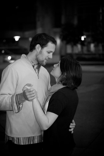 Engaged couple dancing, black and white photo