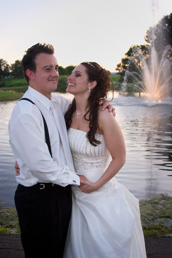 Bride and Groom by pond with fountain