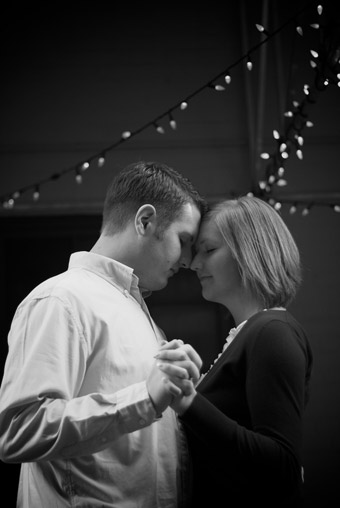 Black and white of engaged couple dancing, enjoying each other's company