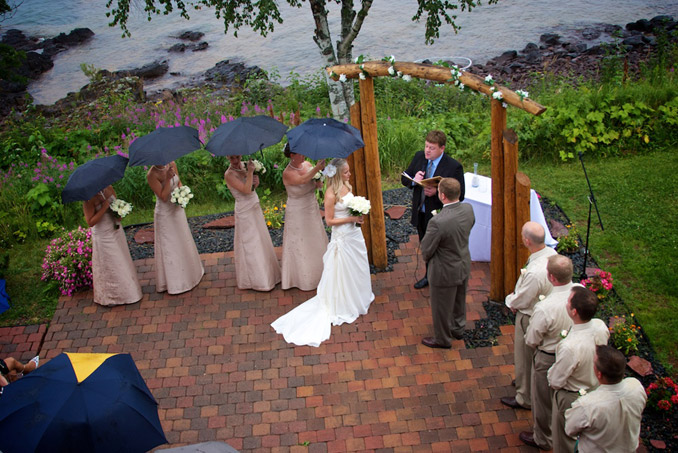 Aerial view of wedding ceremony on shore of Lake Superior