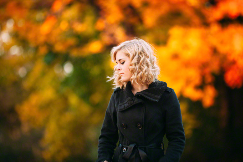 senior girl with jacket and fall leaves