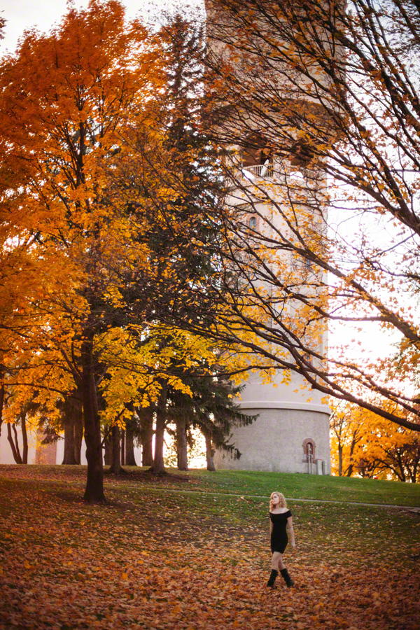 Senior girl in black dress in front of Rochester MN historic watertower in fall
