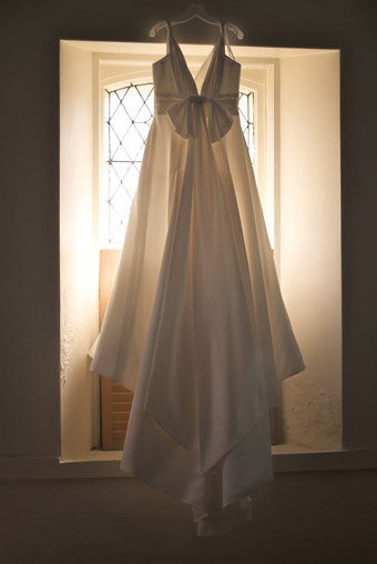Wedding Dress backlit in window