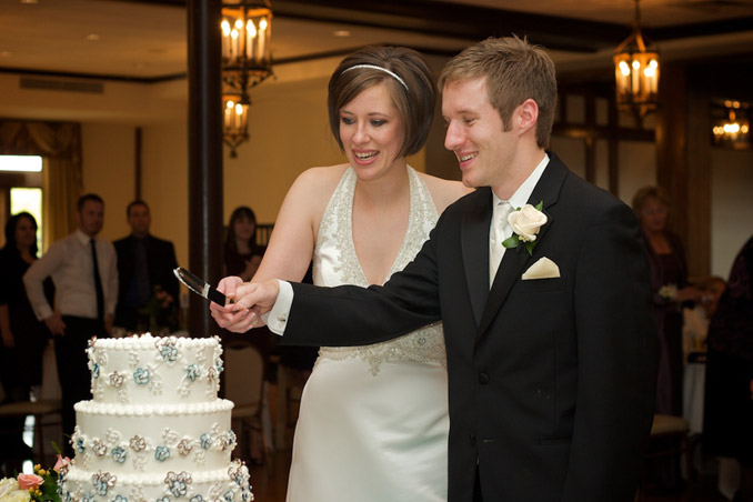 Bride and Groom cutting wedding cake at beautiful Chevy Chase Reception hall