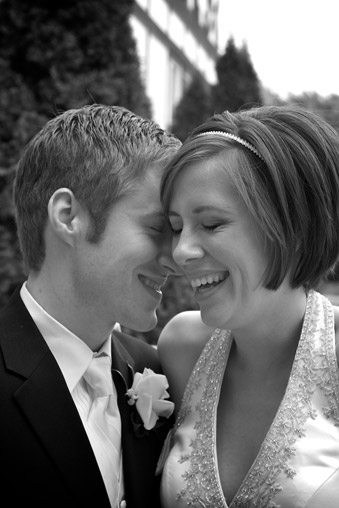 Tender moment with bride and groom - black and white