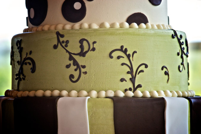 Ornate, green, brown and white wedding cake