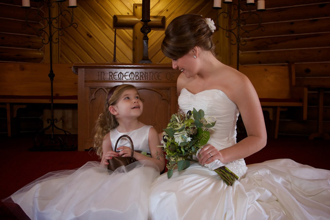 Tender moment with bride and flower girl