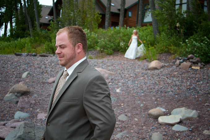 First Look: Groom waiting to see bride on shoreline, Lake Superior