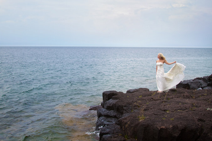 Bride on rocky shoreline of beautiful Lake Superior