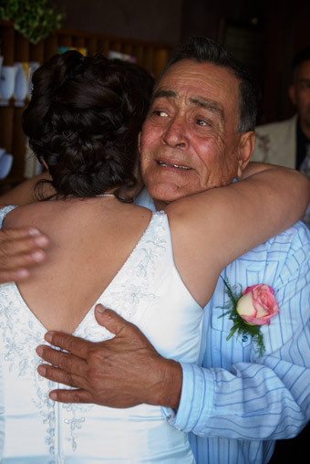 Father embracing bride before ceremony